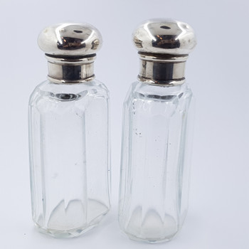 PAIR OF VINTAGE GLASS BOTTLES WITH SILVER TOPS #43130
