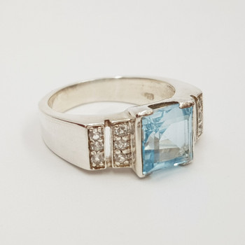 This ring has been made from sterling silver and with a topaz as the main feature stone flanked on either side by cz stones. This ring is new but may have some slight marks from general handling.