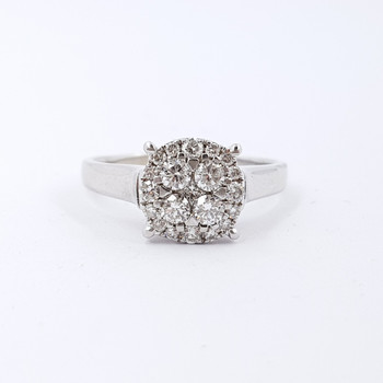 This lovely white gold ring has a flat face design set with round brilliant cut diamonds.
