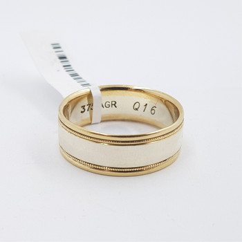 This wedding band is made from two tone 9ct yellow and white gold.