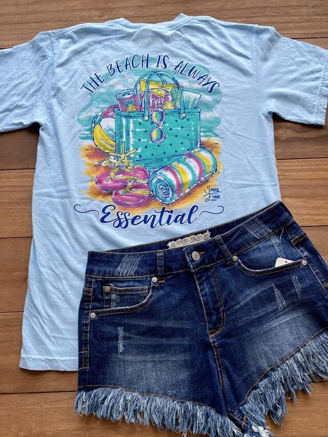 A graphic beach tee with cut-off jean shorts