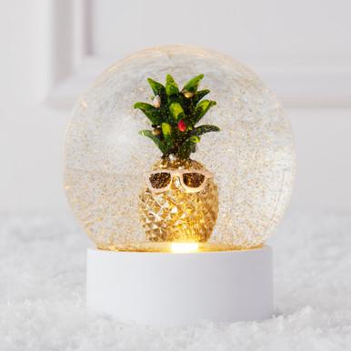Festive Pina Snow Globe