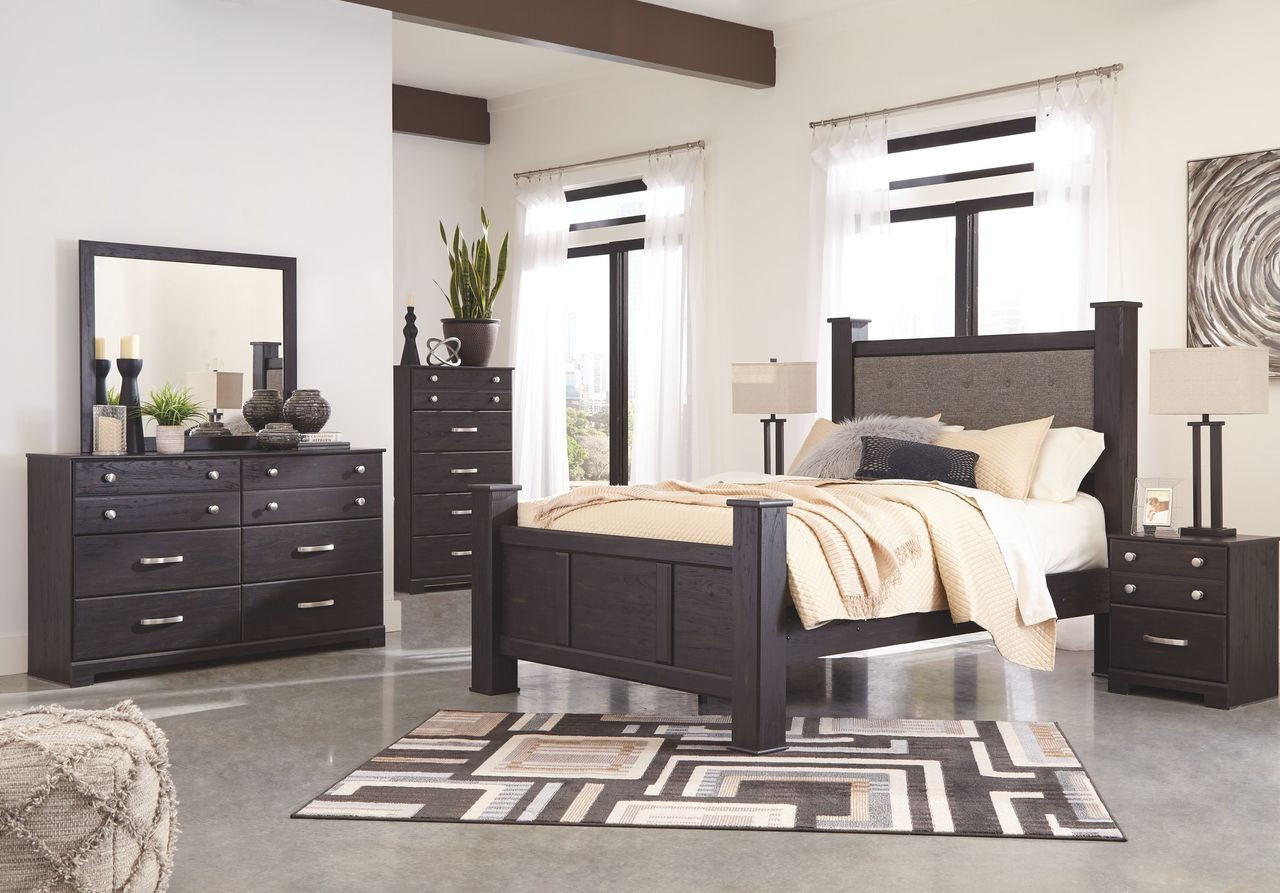 The Reylow Dark Brown 7 Pc Dresser Mirror Queen Upholstered Poster Bed 2 Nightstands Available At Gibson Mcdonald Serving Waycross Ga And Surrounding Areas