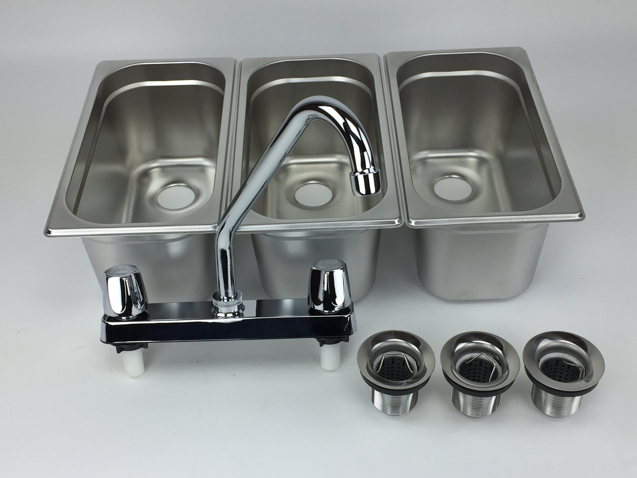 4 basin sink with faucets angled view