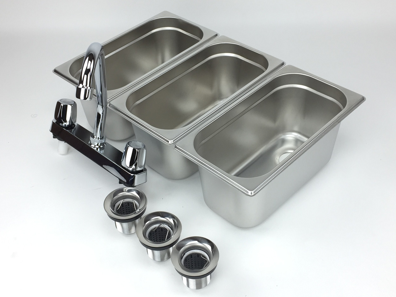 4 basin sink with faucets right angled view
