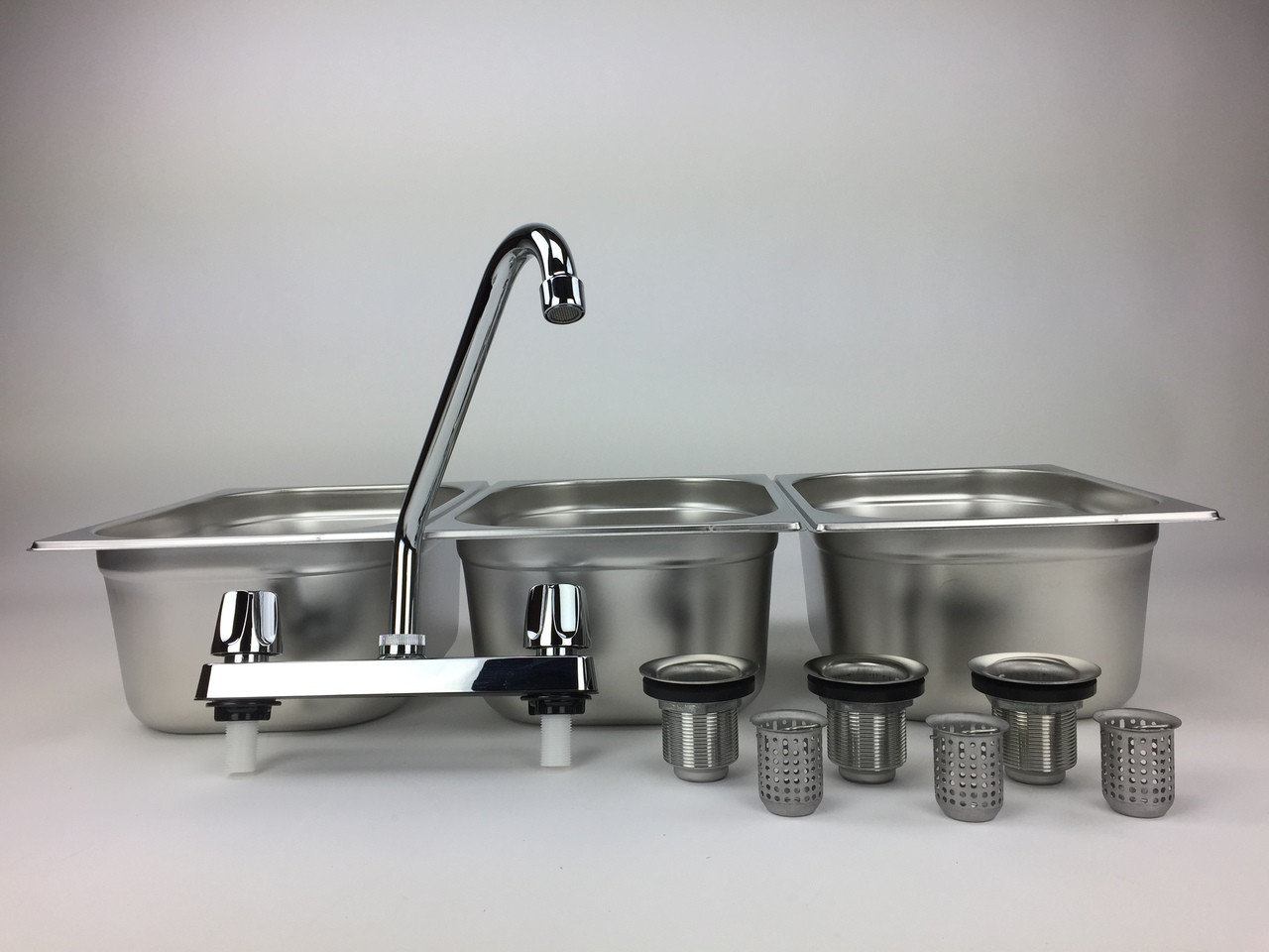 4 basin sink with faucets and drains left angled view