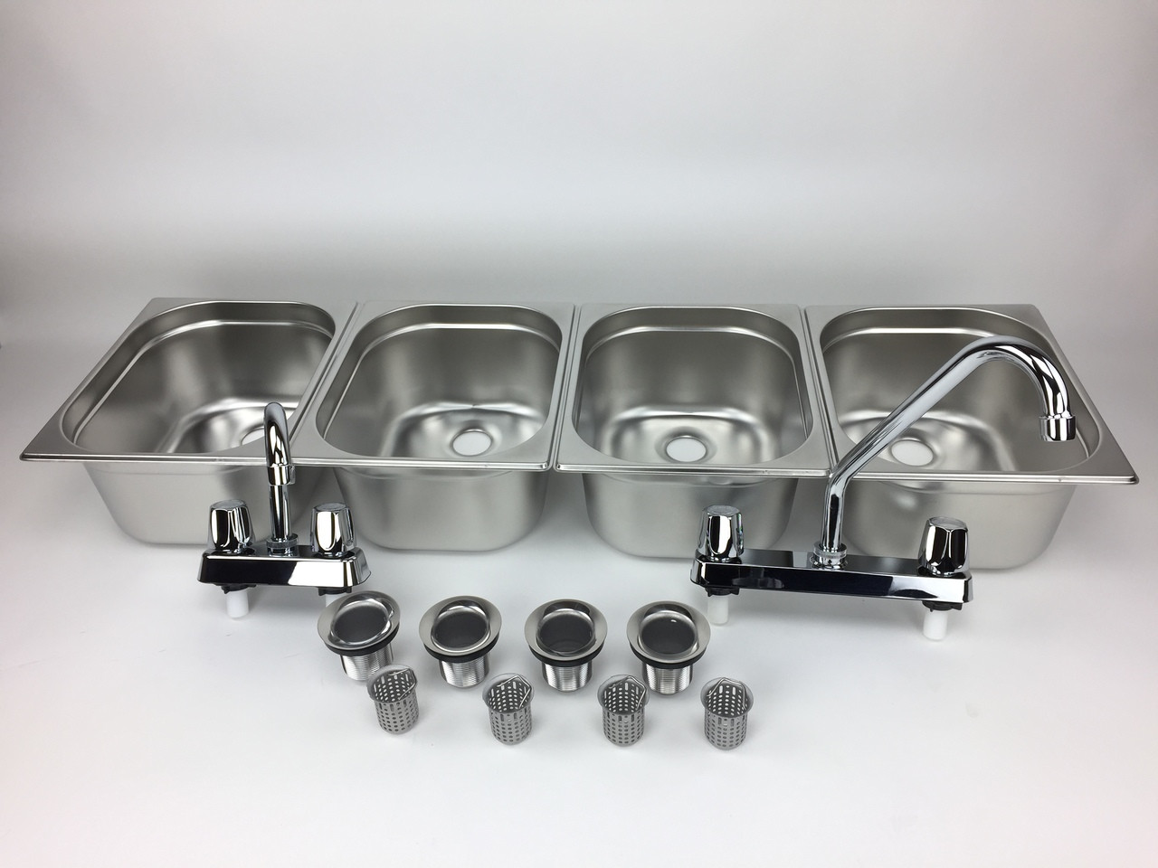 4 basin sink with faucets and drains  front view