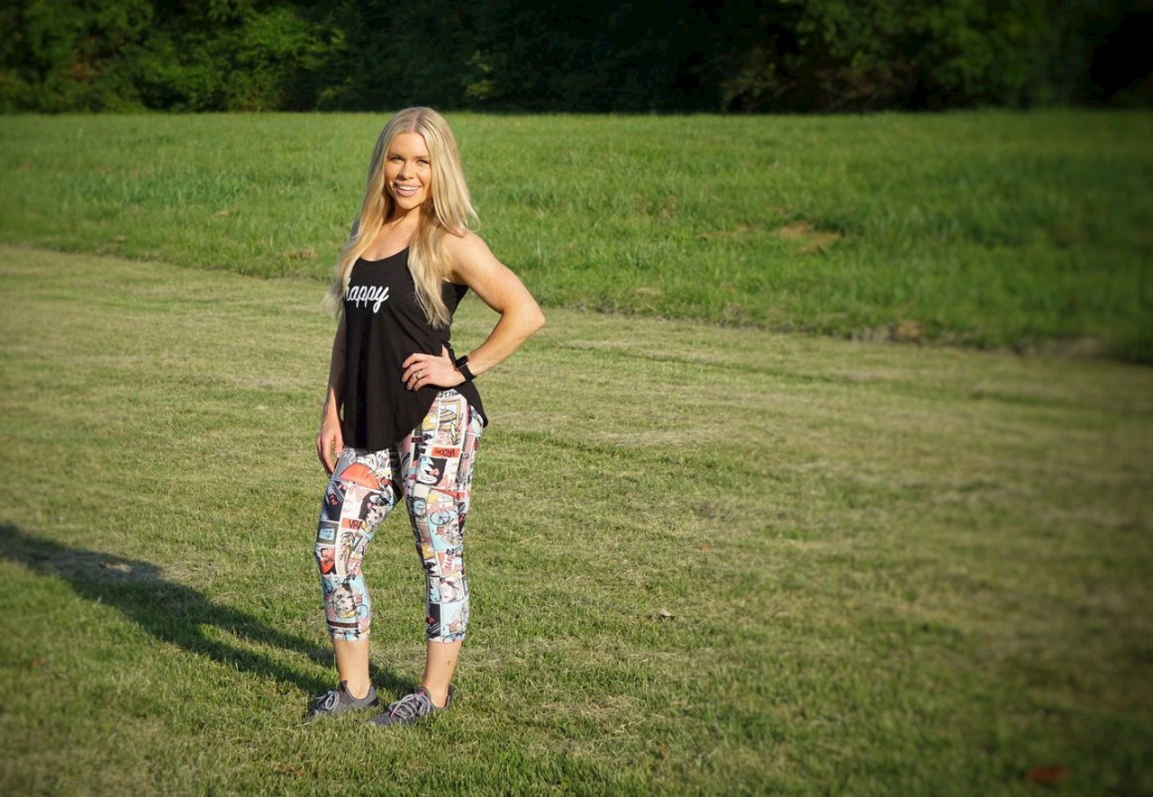 Sewn with Sunshine banner woman in field wearing Activewear