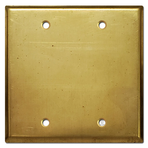 Distressed brass covers for 2-gang electrical box.