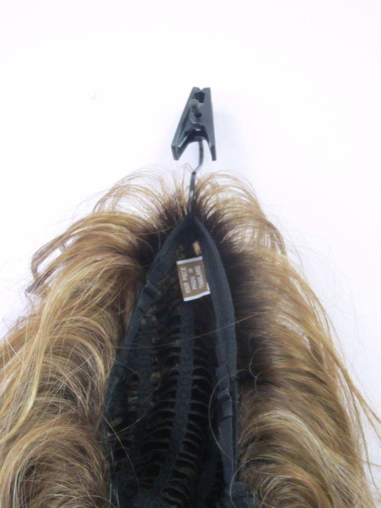 Use the Wig Hanger upside down and hook it through your wig
