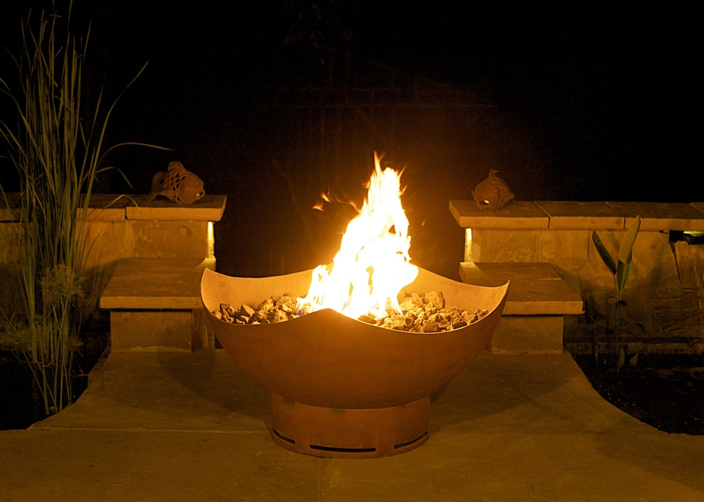 Manta Ray fire pit offered in wood burning, liquid propane or natural gas fueled.