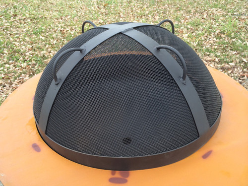 Artisan Spark Guard created using stainless steel mesh and bar.  Fits Fire Pit Art Magnum