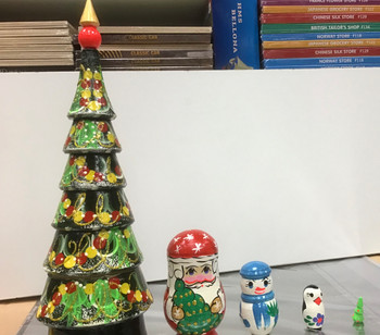 Wooden Xmas tree with 4 pieces which go inside each other