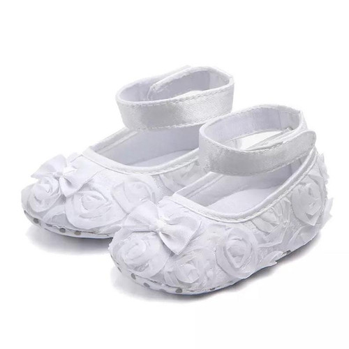 White rose baby shoes perfect for weddings, baptisms, and christenings.
