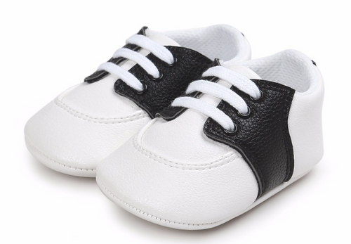 baby black and white saddle shoes