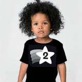 a child is wearing a black and white second birthday t shirt