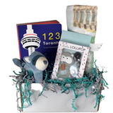a group of baby items with a toronto theme, book, toys and a swaddle blanket