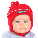 a baby with peach skin and grey eyes wearing a red snug as a bug fleece hat