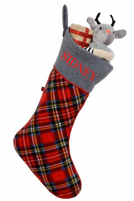 """a tartan christmas stocking personalized with """"Sydney"""", it is filled with gifts"""