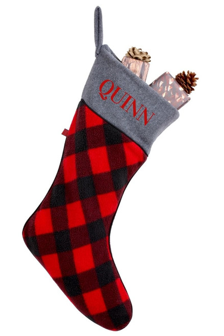 """a Snug As A Bug Canada Plaid Christmas stocking filled with gifts, personalized with the name """"Quinn"""""""