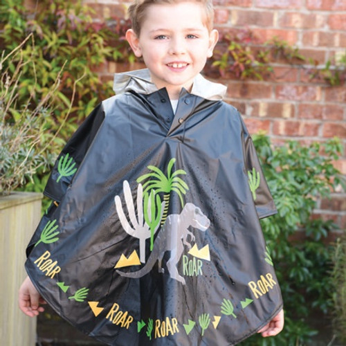 a child is wearing a navy rain poncho with diosaur decoration