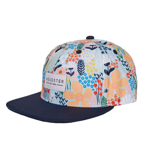 Headster Kids snapback cap, floral print with pale blue background and black visor