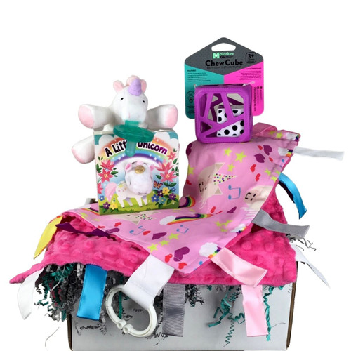 an assortment of unicorn themed baby gifts in a box