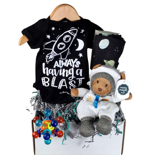 Outer space themed baby gifts: a onesie, a soft astronaut toy, a teether and a swaddle