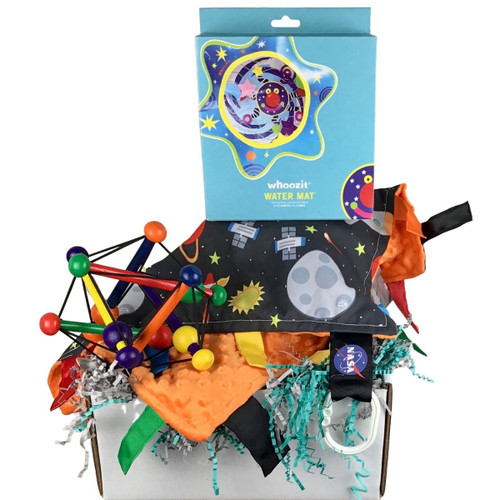 Baby box curated by Snug as a bug: space themed baby items shown in box