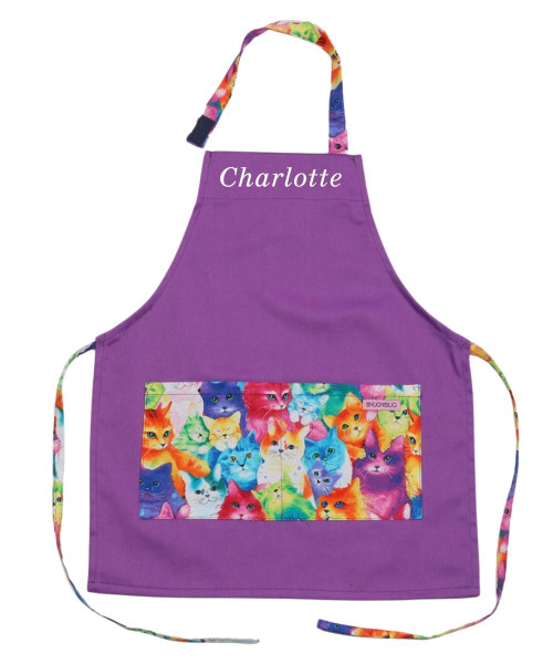 Snug As A Bug kids apron, purple with colourful kitten print trim, shown personalized