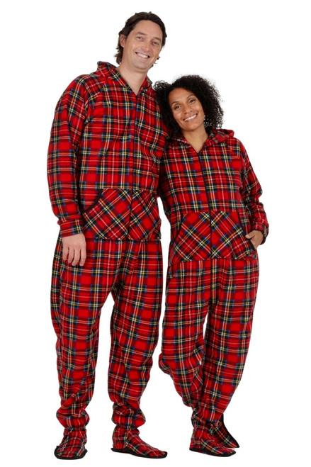 two adults wearing red tartan footie pajamas