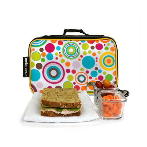 urban infant lunch bag in multicolour planet print is shown with a sandwich and a glass container of small carrots
