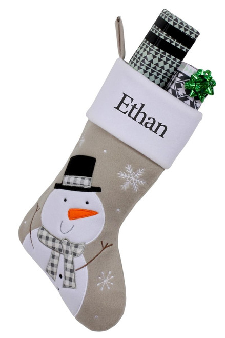 """Snug As A Bug Modern Grey Christmas stocking, Snowman, personalized """"Ethan"""" and filled with small wrapped gifts"""