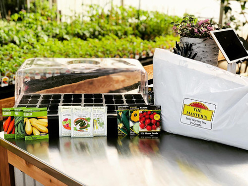 A complete seeding kit with tray, pack insert, seedling soil mix and your choice of three standard seed packets.
