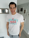 """Target Item #82020613 Men's Standard Fit Short Sleeve Crew Neck T-Shirt. """"I am 6'1"""" and I have a 42"""" chest. I am 35"""" at the waist and 40"""" around the hips. i love the vintage motif of summer games 1984!!! how timely as the olympics are this year. i love the aqua and pink design, it feels very summer-ish!!! you can never have enough white tee's for summer! i love the fit, appreciate the fit of the arm and overall length of it! long live summer and at a steal of a price!. This item does not have pockets. I received an incentive to write this review. But this is my honest review. Hope it helps!"""" Shop this item at https://www.target.com/"""