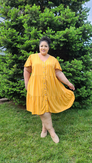 """Target Item #82111177 Women's Plus Size Short Sleeve Button-Front Tiered Dress """"I am 5'6"""" and I wear a 48G bra size. I am 48"""" at the waist and 60"""" around the hips. This yellow and pink striped dress is totally cute. I love how flowy it is and it has pockets! I mean who doesn't love pockets?! This is definitely a must have for your spring and summer closet. This item has pockets. I received an incentive to write this review. But this is my honest review. Hope it helps!"""" Shop this item at https://www.target.com/"""
