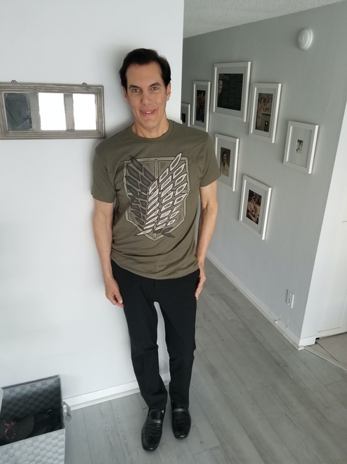 """Target Item #82567666 Men's Attack On Titan Logo Short Sleeve Graphic T-Shirt. """"I am 6'1"""" and I have a 42"""" chest. I am 35"""" at the waist and 40"""" around the hips. army green is a welcome color/design in my summer wardrobe. the front design looks sharp and inspired me to wear it with jeans, shorts, sweatpants for leisure wear or even to the gym. the cotton is soft. size large fits perfectly. i appreciate the length as a tall person it did not feel short on me. the quality is rich in feel and reasonably priced!. This item does not have pockets. I received an incentive to write this review. Hope it helps you!"""" Shop this item at https://www.target.com/"""