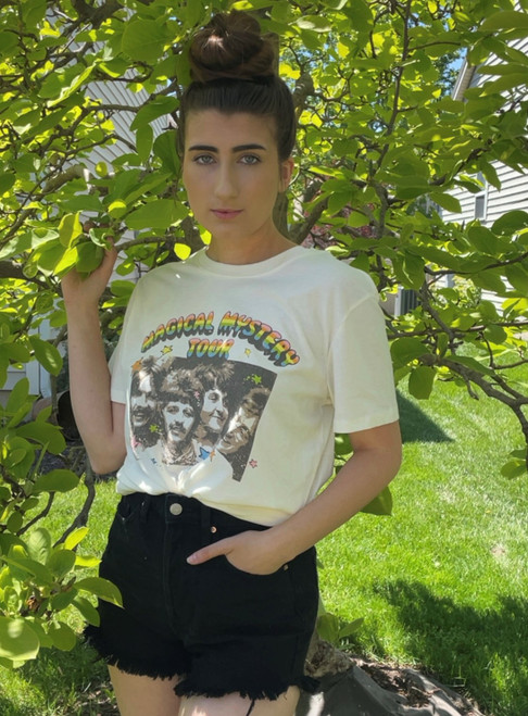 """Store Item #82102202 Women's The Beatles Short Sleeve Graphic Boyfriend T-Shirt """"I am 5'5"""" and I wear a 32B bra size. I am 26"""" at the waist and 37"""" around the hips. this shirt is very comfortable and i would wear this tied in the front so it is more form fitting. i like the back print on the top and i would wear it with some ripped high waisted shorts and a pair of vans. This item does not have pockets. I received an incentive to write this review. Hope it helps you!""""  Shop this item at https://www.target.com/"""