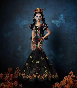 Inspired by the traditional Mexican holiday, this stunning doll features a flaminco-styled dress decorated in printed flowers, a marigold floral crown, and her face is painted as skull.