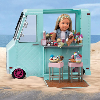 Everyone loves the ice cream van, and dolls are no exception! The Sweet Stop Truck could be your doll's first business as they serve up ice cold treats to their friends SUITABLE FOR: Children aged 3 to 10 years old with a sweet tooth WHY OUR GENERATION DOLLS: More than just your average doll, the OG dolls believe in making a difference in their world. They want to build a community of friends and help your little one to learn new hobbies and always do the best they can. WHAT'S IN THE BOX: The Sweet Stop Ice Cream Truck comes with 2 stools, 4 pieces of chalk, a customer bell, napkin holder, 6 paper bills, 3 coins, 2 ice cream cone holders, a popsicle holder, 3 containers, 3 drinking cups, 3 ice cream cups with syrup bottles, a coloured sprinkle shaker, a chocolate sprinkle shaker, 6 ice cones, 2 ice cream cones topped with nuts, 3 slushies, 3 doughnut trays, 2 swirl popsicles, 2 ice cream sandwiches, 3 pretzels, 6 trays with ice cream, 6 round popsicles, 3 cruller doughnuts, ice cream in a waffle cone, a soft ice cream in a cup, 3 soft ice cream cones, 2 chocolate dipped popsicles, 2 dipped popsicles with nuts, 3 double popsicles, 2 clusters of ice, 2 milkshakes with whipped cream topping, 2 flavoured ice cream cones with 2 paper cups, a large sundae, 6 doughnuts, 3 sundaes in a cup, 15 popsicles, 4 serving trays, 2 fridge racks and a deep fryer basket