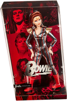 In the definitive celebration of two pop culture icons, Barbie honors an utmost pop chameleon, English singer, songwriter and actor, David Bowie This collectible Barbie doll wears the metallic Ziggy Stardust space suit with red and blue stripes, flared shoulders and Bowie's signature cherry-red platform boots Special details include bold makeup - featuring the famed astral sphere forehead icon - and a hairstyle inspired by Bowie's fiery-red locks Specially designed packaging makes Barbie David Bowie an utmost collector's item for Bowie and Barbie fans alike Honor David Bowie's extraordinary talent and undeniable influence with Barbie David Bowie doll