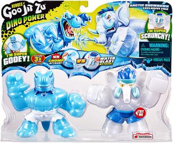 """The Arctic Showdown Versus Pack is designed to be a battle straight of the box. Includes 2 Heroes of Goo Jit Zu to stretch, battle and play with Arctic Showdown Tyro & Gigatusk both feature a unique, exclusive ice look exclusive to this pack Tyro features the new """"Chomp Attack"""" feature while redback Gigatusk hs the Water Blast attack… Who will win Collect all the GJZ Dino Power Heroes! And prepare for the ultimate squishy dino battle Tyro is super gooey! Squeeze his body and watch his clear, squishy filling bulge out to reveal dino teeth inside him! Gigatusk is super scrunchy! Squeeze his body and scrunch his insides Both Tyro and Gigatusk can stretch and squish! They will always come back to their original shape! They can stretch up to 3 times their size"""