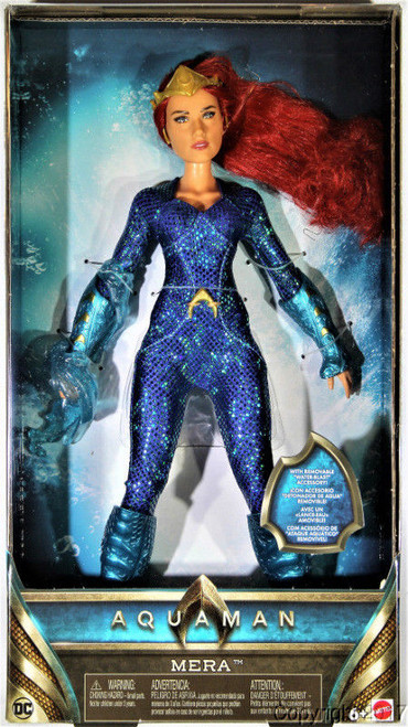 """12"""" scale Mera fashion doll with state of the art actress likeness Shimmering, soft goods, aqua scaled, battle suit Accessories include gauntlets, boots, tiara and water blast super power Jumpsuit and accessories are removable for fashion doll play You can also choose Mera doll in her premium jellyfish gown! Sold separately, subject to availability"""