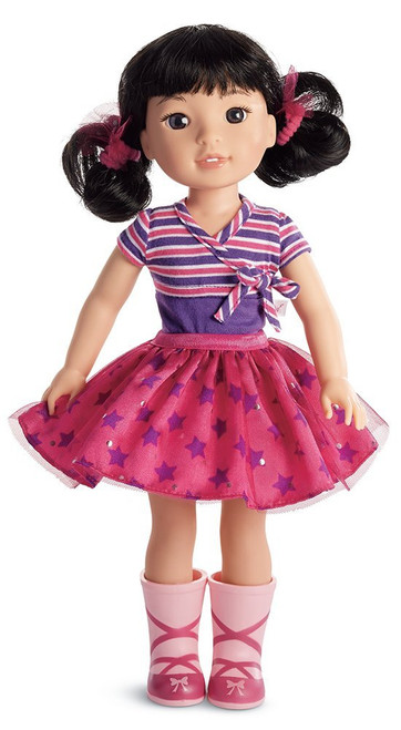"""Emerson loves the spotlight-and the spotlight loves her right back She loves to make her friends smile with funny jokes, original dance routines, and show-stopping songs This 14.5"""" (36.8 cm) doll is sized just right for younger girls She has dark-brown eyes and black hair in curly pigtails Collect all of your favorite welliewishers!"""