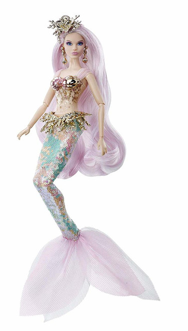 The second installment of the mythical muse fantasy series, Barbie mermaid Enchantress doll features an enchanted look with sea-inspired details. Barbie doll's fantastical design features a Mermaid tail with fish-scale sequins in soft coral and sea-foam hues. Sea-inspired accessories, including a golden, coral-themed headpiece, peplum and wrist-cuff, finish Barbie doll's enchanted look. Barbie mermaid Enchantress doll's hair Features pink and blue highlights and is styled in flowing waves with a delicate braid. This collectible Barbie doll includes a Certificate of Authenticity and makes the perfect gift for fans and collectors.