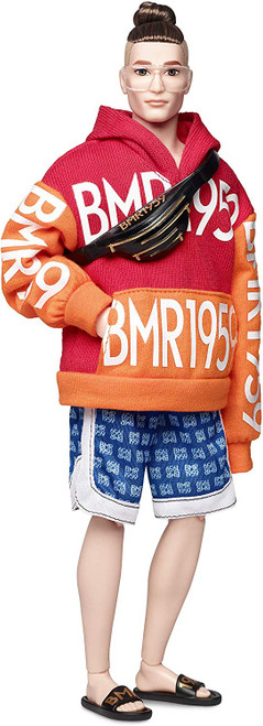 """BMR1959 celebrates the 60-year fashion legacy of Barbara """"Barbie"""" Millicent Roberts with a collection that's all about self-expression and personal style. Bold, fully poseable BMR1959 dolls capture what's trending in streetwear, from high-low fashion mixes, re-imagined '90s gear to juxtaposed patterns, textures, and silhouettes. This BMR1959 doll wears an orange and red hoodie with blue logo-print shorts. He accessorizes with aviator-style glasses, a cross-body bag and slides, all with gold details. A cool bun hairstyle finishes the look. Specially designed, FSC-certified shoebox packaging is made from materials that have been responsibly sourced."""