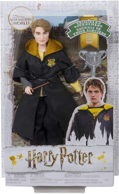 """Fans and collectors can relive their favorite movie moments and imagine their own magical stories with Harry Potter Triwizard Tournament dolls! This film-inspired Cedric Diggory doll wears a personalized First Task robe with true-to-movie touches, like mesh details and the Triwizard Tournament emblem. Kids' stories come to life with a Triwizard Cup accessory and wand that's based on his character's in the film. With """"joints"""" in the neck, shoulders, hips, knees, elbows and wrists, Cedric doll is ready for action-play and spellbinding poses! Harry Potter Triwizard Tournament dolls make a great gift for kids 6 years old and up. Collect to build out the wizarding world and create your own magical stories (each sold separately, subject to availability)."""