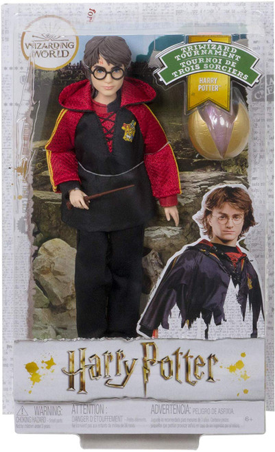 """Fans and collectors can relive their favorite movie moments and imagine their own magical stories with Harry Potter Triwizard Tournament dolls! This film-inspired Harry Potter doll wears a personalized First Task robe with true-to-movie touches, like mesh details and the Triwizard Tournament emblem. Kids' stories come to life with a golden egg accessory and wand that's based on his character's in the film. With """"joints"""" in the neck, shoulders, hips, knees, elbows and wrists, Harry Potter doll is ready for action-play and spellbinding poses! Harry Potter Triwizard Tournament dolls make a great gift for kids 6 years old and up. Collect to build out the wizarding world and create your own magical stories (each sold separately, subject to availability)."""