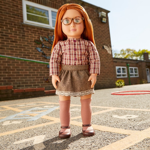 """Your little one will love the April 46cm/18"""" doll from the Our Generation range! April is our glasses girl with eyes so pretty they just had to be framed with some cute tortoise shell spectacles. With her beautiful soft auburn hair and autumnal outfit she's is just waiting to be adored."""