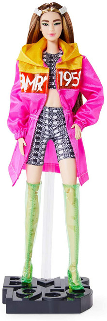"""BMR1959 celebrates the 60-year fashion legacy of Barbara """"Barbie"""" Millicent Roberts with a bold, streetwear-inspired collection that's all about personal expression and style. This fully poseable BMR1959 Barbie doll sports a color block parka over her cropped tank and bike shorts. Bold details include green painted fingernails, statement eye liner and clear vinyl thigh-high boots with a neon block heel. Barbie doll's long brunette hair is accented with chunky, 90's-inspired highlights and logo hair clips. Specially designed, FSC-certified shoebox packaging is made from materials that have been responsibly sourced."""